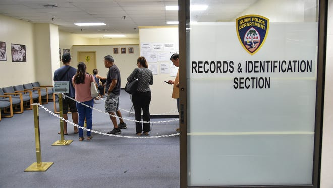 Customers form a queue at the Guam Police Department's Records and Identification section at the International Trade Center on Oct. 19, 2016. The Philippines-based Delgado family, owners of the International Trade Center, gets paid about $3.7 million a year in rent from various local government tenants.