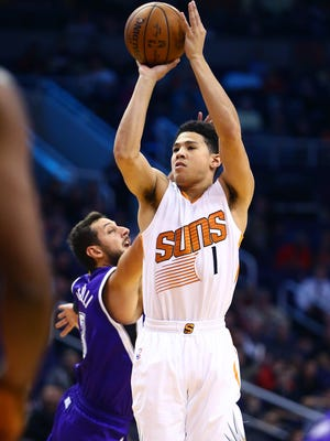 Nov. 4, 2015; Phoenix; Suns guard Devin Booker (1) shoots against the Sacramento Kings in the second quarter at Talking Stick Resort Arena.