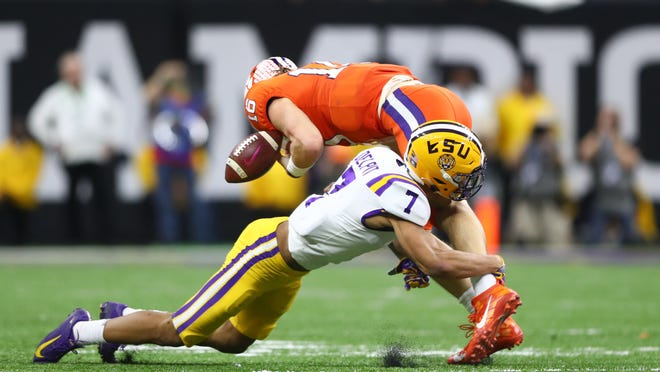 LSU Tigers safety Grant Delpit (7) tackles Clemson Tigers quarterback Trevor Lawrence (16) in the College Football Playoff national championship game at Mercedes-Benz Superdome in January.