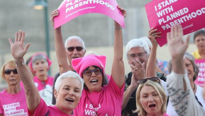 Planned Parenthood holds a support rally at Frances Stevens Park in Palm Springs. Planned Parenthood could lose federal monies if legislation reforming the Affordable Care Act goes into effect.