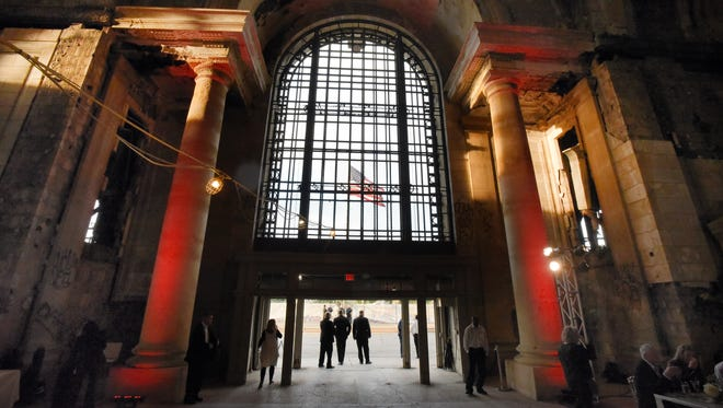 The American flag is seen through the front entrance at the Michigan Central Depot in Detroit.