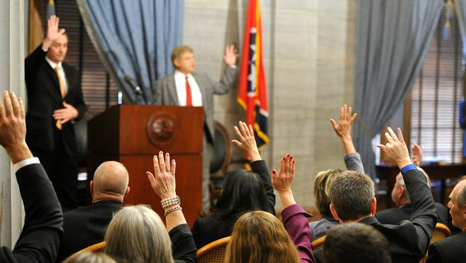 House Republican Caucus Chairman Glen Casada, R-Franklin, asks for a show of hands from members who wanted to make the meeting to decide the fate of House Majority Whip Jeremy Durham closed to the media on Jan. 12, 2016, in Nashville.