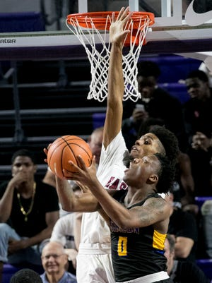 Chicago Simeon's Kejuan Clements is guarded by Ryan Boyce of Memphis East as he looks for an open shot in the first semifinal of the Culligan City of Palms Classic on Friday, Dec. 22, 2017, in Fort Myers.