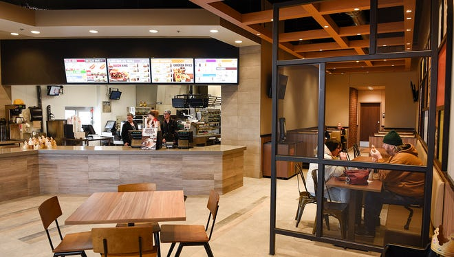 "The new Burger King restaurant shown Thursday, Dec. 29, in Sartell. The store is the first in state with a ""garden grill"" design, which includes open interior with trusses and spotlights."