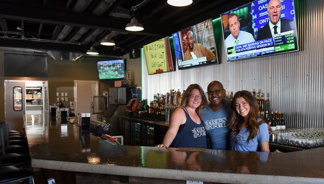 "From left. Art's Pub front of the house and bar managers  Katie O'Brien, Brandon Henderson, and Macy ""TW"" Greer, pictured Monday, June 11, 2018.  The bar officially opens Monday, June 18."