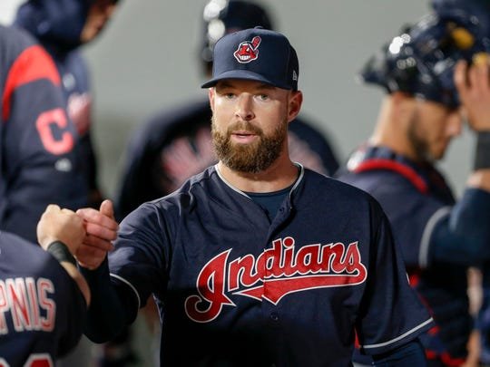 Cleveland Indians pitcher Corey Kluber receives congratulations from his teammates in the dugout after another fine outing.