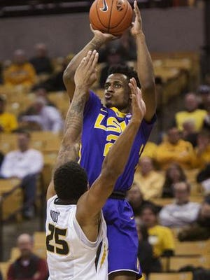 LSU's Antonio Blakeney, top, shoots over Missouri's Russell Woods, bottom, during the second half of Wednesday's game. Blankney led all scorers with 24 points.