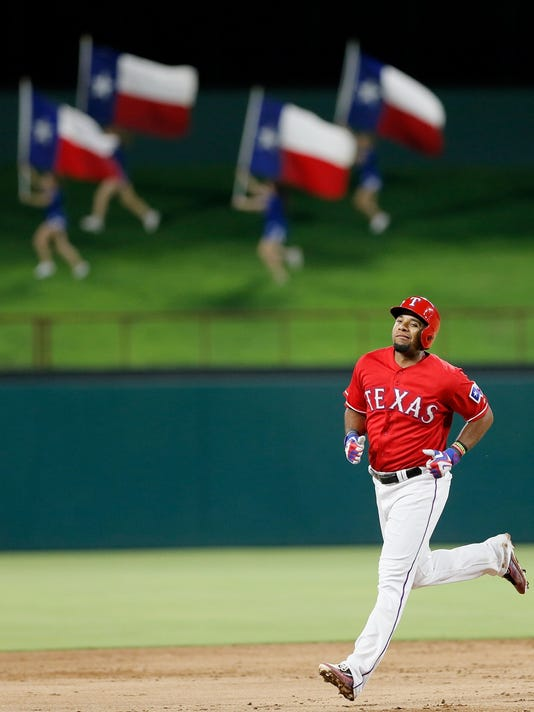 Texas Rangers' Elvis Andrus rounds the bases after hitting a solo home run during the second inning of a baseball game against Minnesota Twins on Saturday, July 9, 2016, in Arlington, Texas. (AP Photo/Brandon Wade)