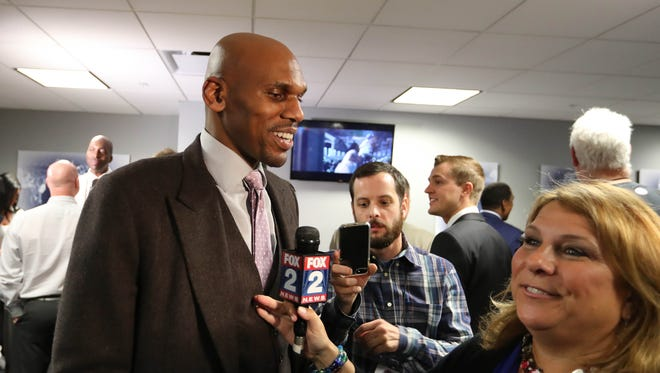 Former Pistons guard Jerry Stackhouse talks with reporters during halftime of the Pistons' 105-101 loss to the Wizards in the final game at the Palace of Auburn Hills April 10, 2017.