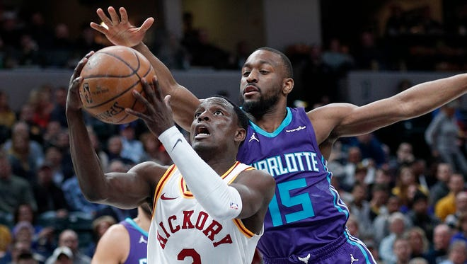 Indiana Pacers guard Darren Collison (2) drives by Charlotte Hornets guard Kemba Walker (15) in the second half of their game at Bankers Life Fieldhouse on Tuesday, April 10, 2018. The Charlotte Hornets defeated the Indiana Pacers 119-93.