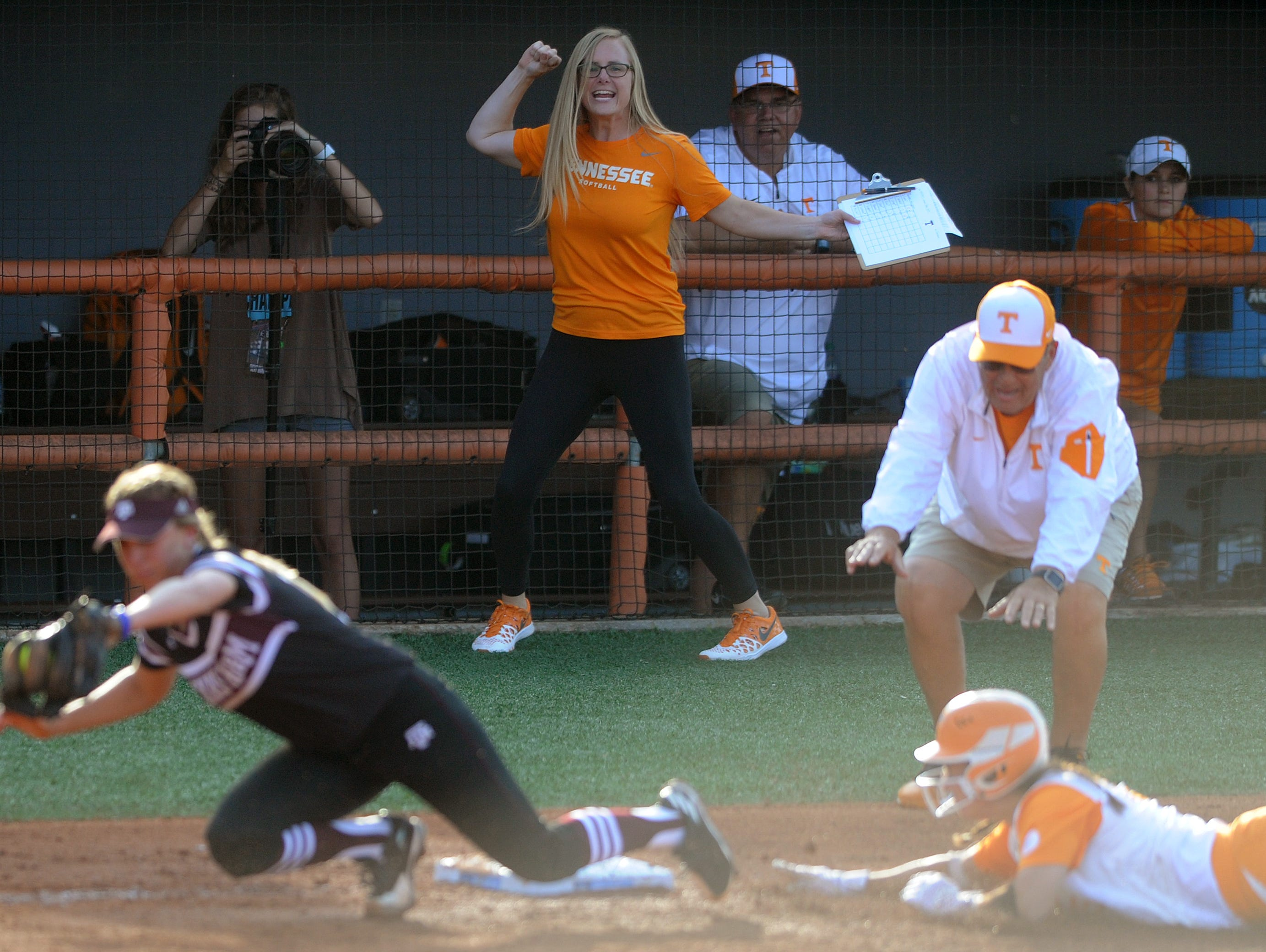 At center Director of Softball Operations Ashley Andrew celebrates as Tennessee's Meghan Gregg (55) slides safely into third base during an NCAA Super Regional game between Tennessee and Texas A&M at Sherri Parker Lee Stadium on Friday, May 26, 2017. Tennessee defeated Texas A&M 8-1.