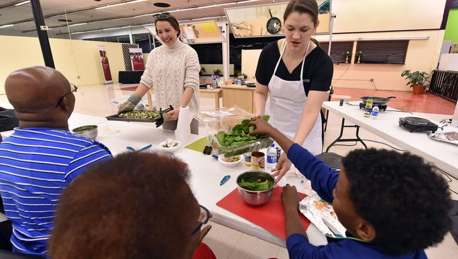 """Josie Bidwell, right, and Rosemary Moak give a cooking class Thursday at the """"Cook Right, Live Well"""" teaching kitchen in Jackson."""