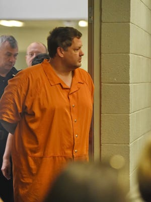 Todd Kohlhepp's enters the courtroom of Judge Jimmy Henson for a bond hearing at the Spartanburg Detention Facility, in Spartanburg, S.C. Sunday, Nov. 6, 2016.  The judge denied bond for Kohlhepp, charged with a 2003 quadruple slaying and more recently holding a woman captive on his property.  (AP Photo/Richard Shiro)