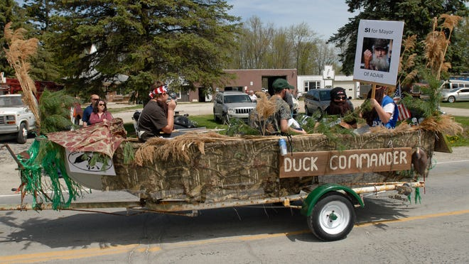 A Duck Dynasty themed parade float makes its way through the parade route.