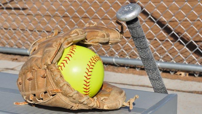 Yellow softball, glove and bat.