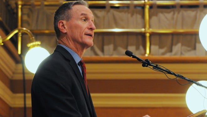 South Dakota Gov. Dennis Daugaard speaks during his budget address at the state Capitol on Tuesday in Pierre. Daugaard proposed broadening eligibility for South Dakota's Medicaid program even though he shares some lawmakers' concerns about expanding it.