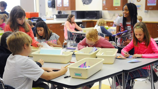 Students work on an assignment during art class in the family and consumer sciences room on this fall at Sartell Middle School. Art class is held in the family and consumer sciences room because of lack of space  at the middle school.
