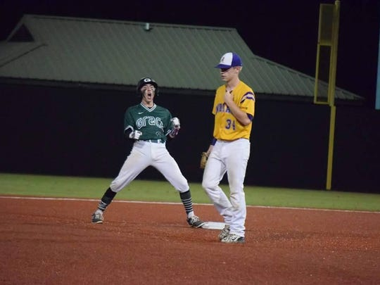 Grace Christian outfielder Josh Gann (left) is overcome with emotion during the LHSAA Class B semifinals last May.