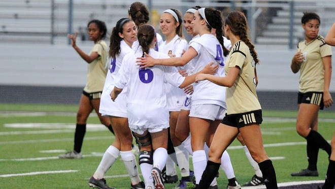 Wylie celebrates a second-half goal during the Lady Bulldogs' 4-3 loss to Wichita Falls Rider at Bulldog Stadium on Monday, March 26, 2018.
