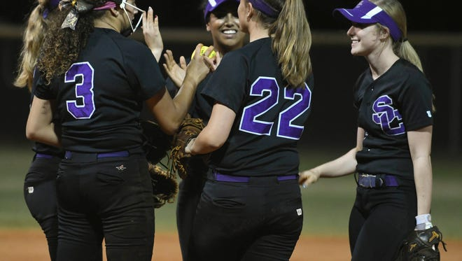 Space Coast players exchange high fives during Wednesday's regional quarterfinal.