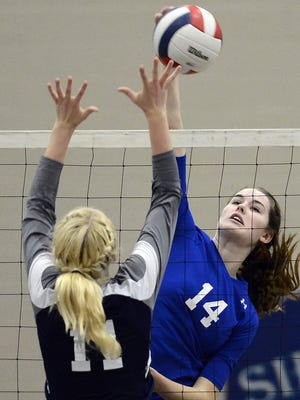Brentwood senior middle hitter Kaela Massey (14) attempts a kill during last year's Class AAA state tournament.