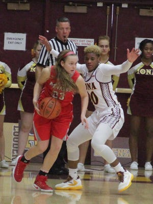 Marist College wing Rebekah Hand, the MAAC, ECAC and Met Writers' 2016-17 Rookie of the Year, dribbled against an Iona defender in this Jan. 15 file photo in New Rochelle.