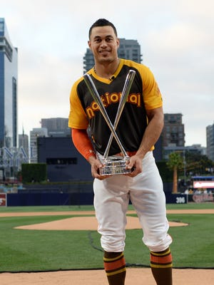 Stanton poses with the trophy after winning the 2016 Home Run Derby.