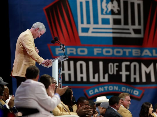 Brett Favre gets choked up talking about his father during his induction speech at the Pro Football Hall of Fame induction ceremony on Aug. 6, 2016, in Canton, Ohio.