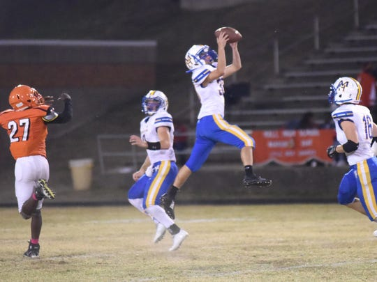 Mountain Home's Hunter Preis makes a leaping interception against Hall on Friday night.