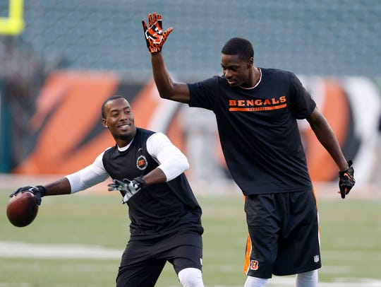 Bengals wide receiver A.J. Green, right, plays with