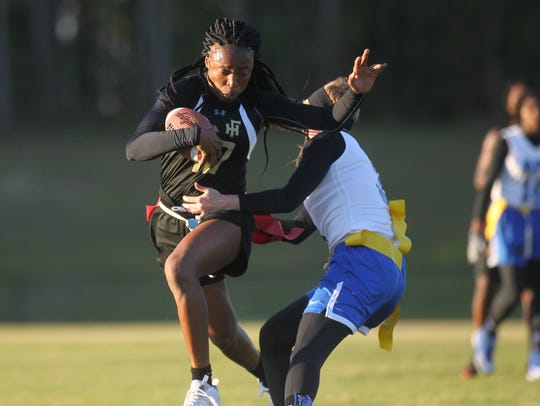 Florida High's Jada Rhodes tries to slip past a Godby