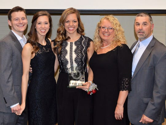 From left, Luke Sellers, Audrey Sellers (Carlie Ainsworth's sister), Carlie Ainsworth, Denise Ainsworth and Ralph Ainsworth at the Alabama Christian Athletics and Fine Arts Hall of Fame induction ceremony.