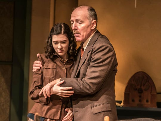 "Otto Frank (Bryan Scott Johnson) comforts his daughter Anne (Emmanuelle Nadeau) in ""The Diary of Anne Frank."""