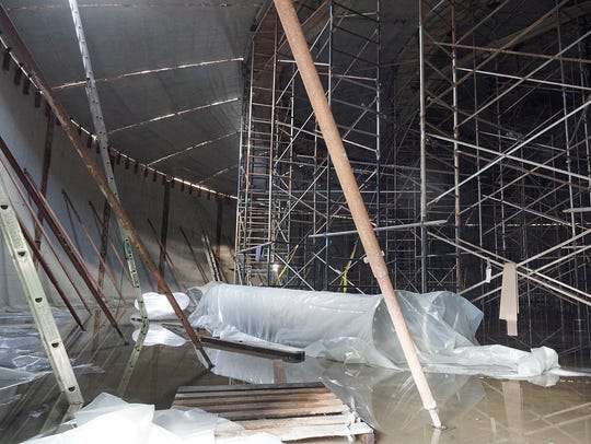 The tank, still under construction, is full of scaffolding.