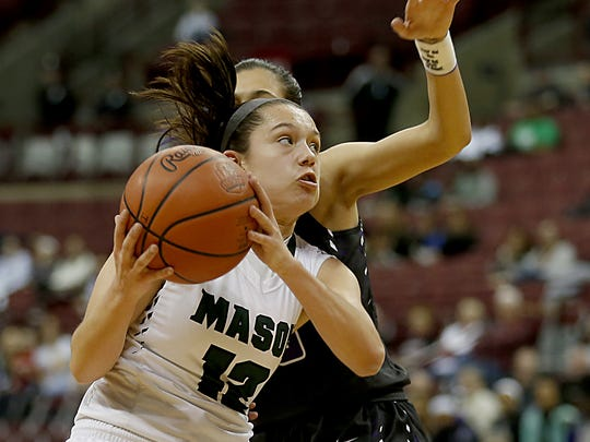 Mason guard Megan Wagner is fouled on the way to the basket by Pickerington Central guard Adrian Crockwell during their Division I semifinal at Jerome Schottenstein Center in Columbus Friday, March 16, 2018.
