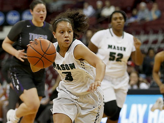 Mason guard Sade Tucker drives up the court against Pickerington Central during their Division I semifinal at Jerome Schottenstein Center in Columbus Friday, March 16, 2018.
