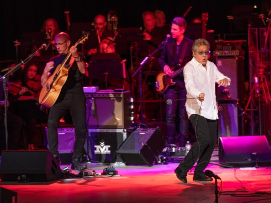 Roger Daltrey of The Who, right, performs June 8 at