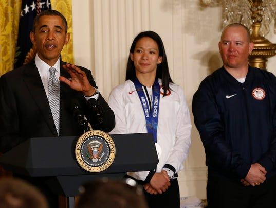 2014-4-3-president-obama-julie-chu-olympics