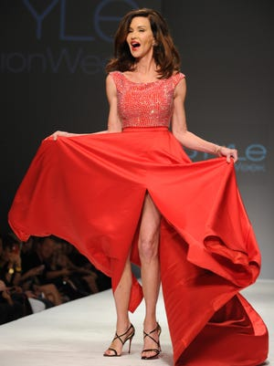 Janice Dickinson walks the runway at the Celebrity Red Dress Fashion Show in March 2015 in Los Angeles,
