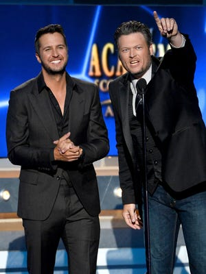 Co-hosts Luke Bryan (L) and Blake Shelton speak onstage during the 49th Annual Academy of Country Music Awards at the MGM Grand Garden Arena on April 6, 2014 in Las Vegas, Nevada.