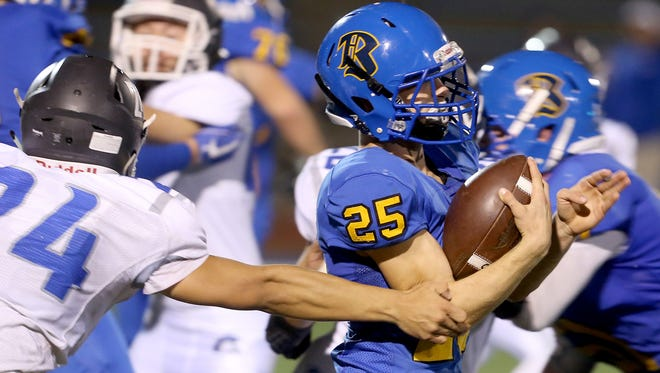 Bremerton's Ryan Saylor (25) had a big night against Olympic on Friday, finishing with 126 rushing yards, one touchdown and three interceptions on defense. Bremerton won 37-23.