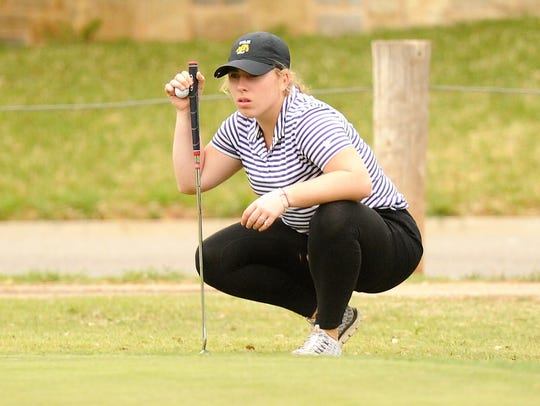 Wylie's Andrea Davis lines up her putt on No. 5 during