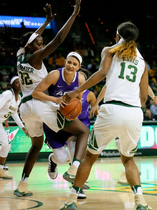 Abilene Christian center Sierra Allen, center, works for a shot opportunity as Baylor's Beatrice Mompremier (32) and Nina Davis (13) defend in the first half of an NCAA college basketball game, Thursday, Dec. 1, 2016, in Waco, Texas. (AP Photo/Tony Gutierrez)
