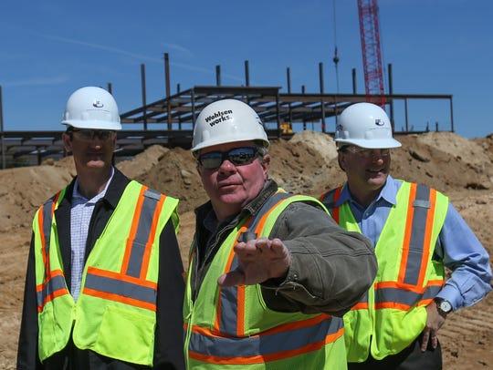 Wohlsen Construction superintendent Bill Zizus, center,