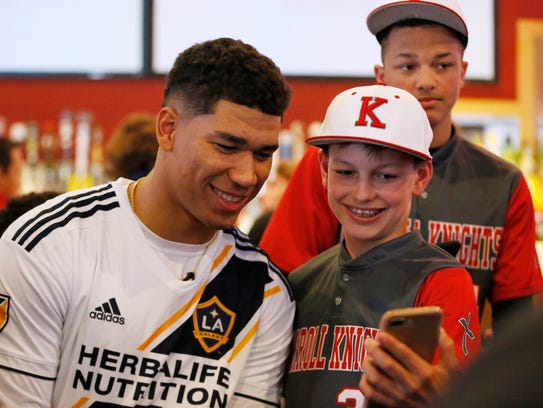 Iowa State's Allen Lazard (left) takes a selfie with