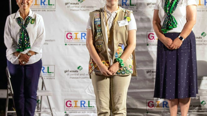 Brianna Williams (center), of Clinton, received her Gold Award, the highest award in Girl Scouts.