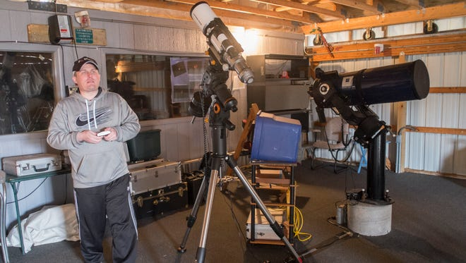 Amateur astronomer and lead volunteer at the Fox Park Public Observatory near Potterville, Jason Blaschka, checks out the weather and decides it is too windy to open the roof of the observatory to view the sun on Sunday. Instead, he and other volunteers begin the spring cleanup.