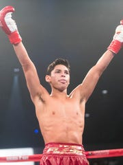 Ryan Garcia, of Victorville, California celebrates his win over Fernando Vargas of Tijuana, Mexico during their bout at Fantasy Springs Casino on March 22, 2018.