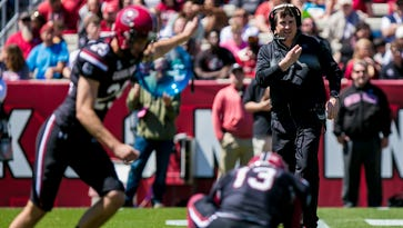 Gamecocks head coach Will Muschamp directs his team from the center of the field during the 2016 Garnet & Black Game at Williams-Brice Stadium in Columbia, SC.