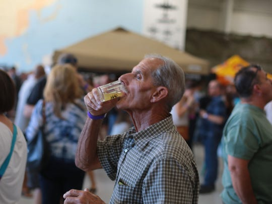 Craft beer lovers attend the 4th annual Props and Hops festival at the Palm Springs Air Museum on Saturday.